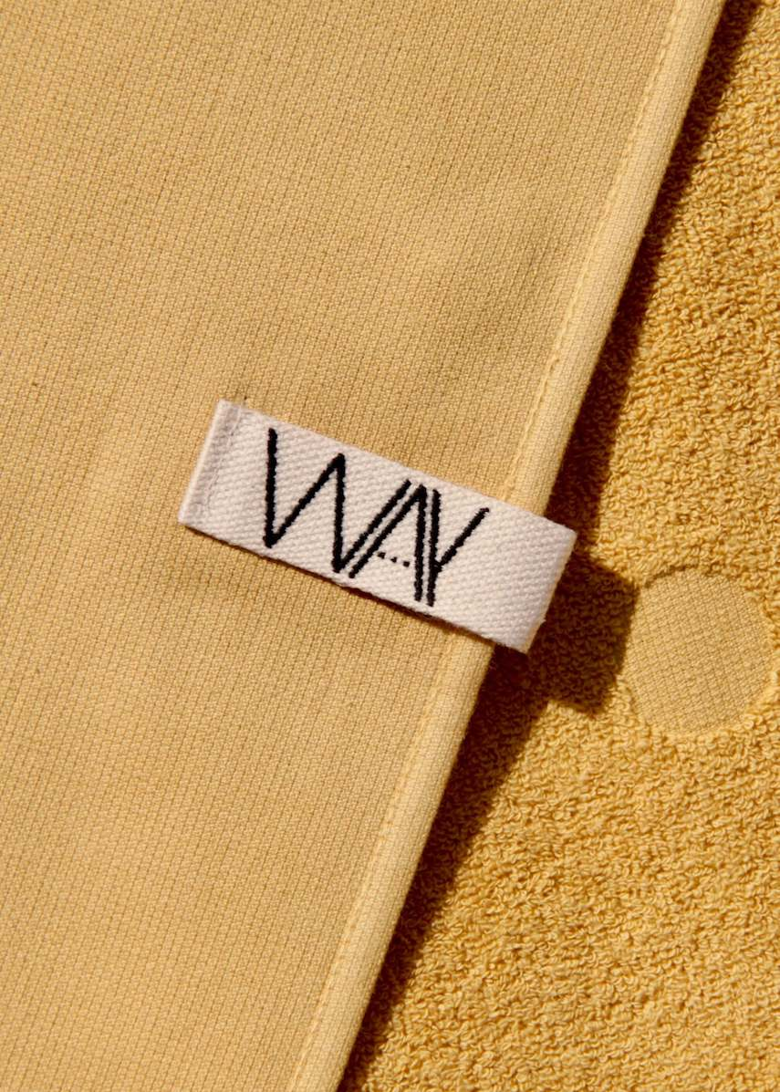 Yellow WAY beach towel with hook detail